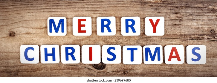 Merry christmas words on the wooden background