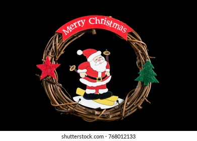 Merry Christmas. A wreath from the vine Santa Claus with gifts.