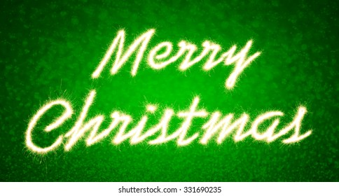 Merry christmas written with Sparkle firework  on green bokeh background