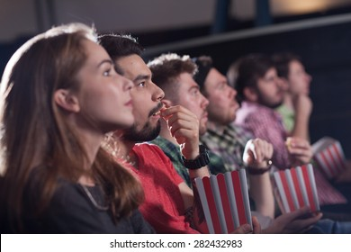 merry company in the cinema, young people watch movies, film,