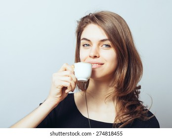 merry cute brunette girl drinking coffee