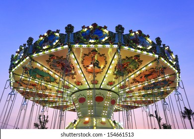 Merry go round by night at Cha-am , Thailand