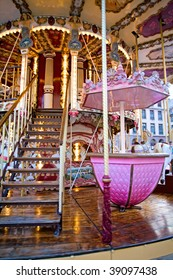 Merry go round carousel illuminated with decorative lights