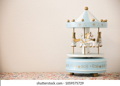Merry go round music box - Musical carousel with blue and white horses
