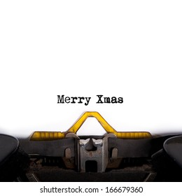 """""""MERRY XMAS"""" message typed by vintage typewriter."""