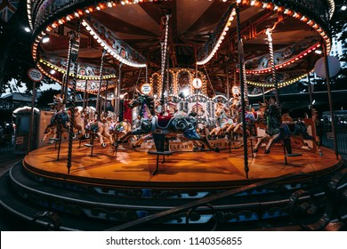 Merry-Go-Round (carousel) at night,  dark blue tone of the photograph make the carousel look horror and creepy