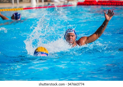 MERSIN JUNE 19:unidentified water polo playersin action during the men. 17. Mediterranean Games match between Italy and France, final score 9 - 6. June 19 , 2013 in Mersin Turkey