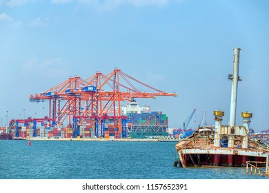 MERSIN, TURKEY - AUGUST 01, 2018: Close-up view of Mersin International Port ( MIP, Turkish: Mersin Uluslararasi Limani) and a shipwreck Mersin flourished as a major port in Mediterranean Sea.