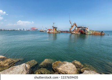 MERSIN, TURKEY - AUGUST 01, 2018: Wide angle view of Mersin International Port ( MIP, Turkish: Mersin Uluslararasi Limani) and a shipwreck. It considerable hinterland in Anatolia, Mediterranean Sea.