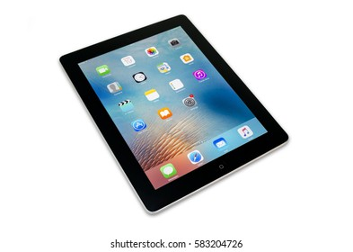 Mersin, Turkey - February 19, 2017: Black Apple tablet ipad with home screen isolated on white background