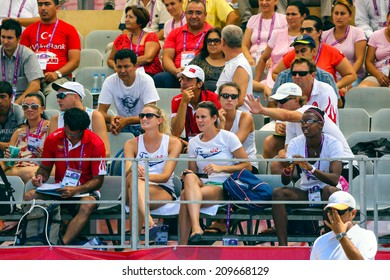 MERSIN, TURKEY - JUNE 25: Unidentified athletes and journalists are watching 17. Mersin Mediterranean Game, Beach Volleyball tournament, on June 25 2013 in Mersin Turkey.