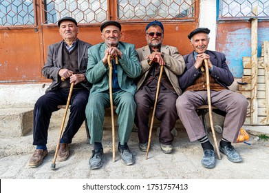 MERSIN, TURKEY - MARCH 10, 2019: There are more than 7.5 million elderly citizens in Turkey. Elderly population are those between the ages of 65 and 74. A group of eldery men sitting on the bench.