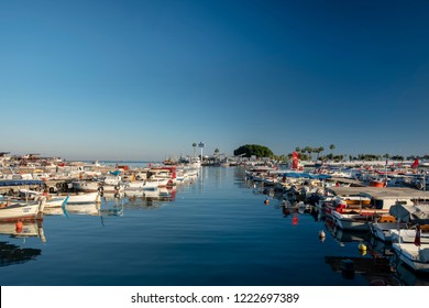 MERSIN, TURKEY, NOVEMBER 1, 2018: Small fishing boats docked at harbor near the city centre, Mersin is a large city and a port on the Mediterranean coast of southern Turkey.