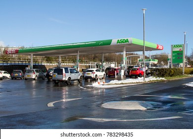 Merthry Tydfil, Wales UK: December 28, 2017: A self-service petrol station at an Asda supermarket. The snow has fallen and people are refuelling their cars incase the conditions get worse.