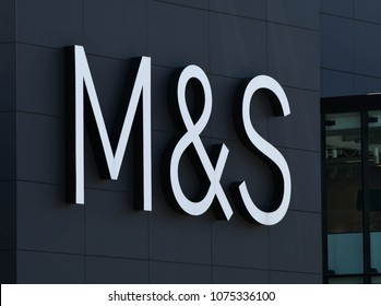 MERTHYR TYDFIL, WALES - APRIL 2018: Large sign with the company name above the entrance to the Marks & Spencer in the town's retail park