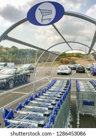 MERTHYR TYDFIL, WALES - JULY 2018: Close up of shopping trolleys under a canopy at the Trago Mills superstore in Merthyr Tydfil