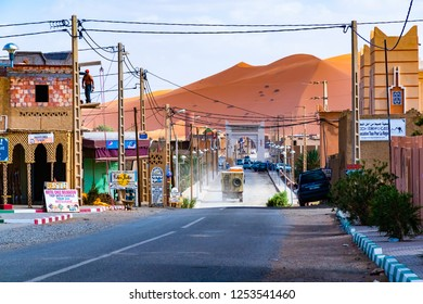 MERZOUGA, MOROCCO - 02 AUGUST 2018: The berber town of Merzouga village with its typical Berber architectural elements in Merzouga, Morocco, Africa