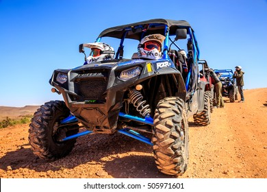 Merzouga, Morocco - Feb 21, 2016: blue Polaris RZR 800 aligned and stationed with no pilot in Morocco desert near Merzouga. Merzouga is famous for its dunes, the highest in Morocco.