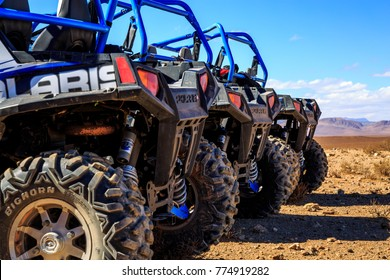 Merzouga, Morocco - Feb 21, 2016: Close-up of wheel of Blue Polaris RZR 800 aligned and stationed with no pilot in Morocco desert