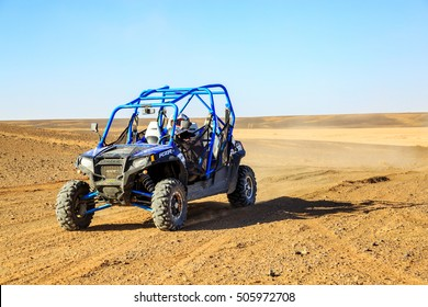 Merzouga, Morocco - Feb 25, 2016: Front view on blue Polaris RZR 800 with it's pilot in Morocco desert near Merzouga. Merzouga is famous for its dunes, the highest in Morocco.