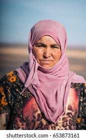 MERZOUGA, MOROCCO - JANUARY 8, 2017: Portrait of Berber woman with the background of Moroccan desert.