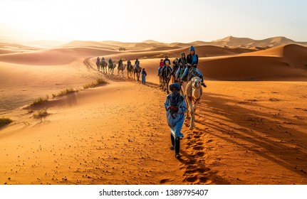 Merzouga, Morocco - May 02, 2019: Caravan walking in Merzouga, Sahara desert on Morocco