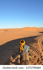 Merzouga is a small Moroccan town in the Sahara Desert. Camel is one of the major transport in the desert.