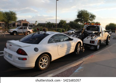 Mesa, Ariz. / US - September 6, 2010: Cars impounded during a joint Mesa and Gilbert police Labor Day sobriety checkpoint operation are loaded for towing. 8018