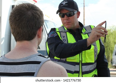 Mesa, Ariz. / US - September 6, 2010: To check their sobriety, Mesa and Gilbert police officers ask drivers suspected of being intoxicated to watch a moving pen during a joint Labor Day event. 7908