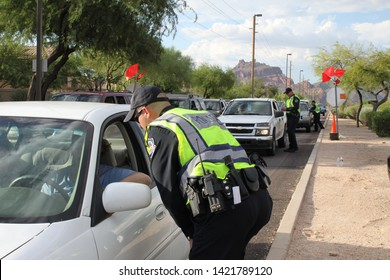 Mesa, Ariz. / US - September 6, 2010: During a joint Labor Day sobriety checkpoint operation, Mesa and Gilbert police officers talk to drivers about the dangers of driving under the influence. 7924