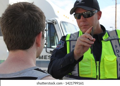 Mesa, Ariz. / US - September 6, 2010: To check their sobriety, Mesa and Gilbert police officers ask drivers suspected of being intoxicated to watch a moving pen during a joint Labor Day event. 7909