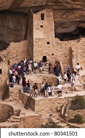 MESA VERDE NATIONAL PARK, CO - JUNE 19: A tour group visits the Cliff Palace ruin on June 19, 2011 at Mesa Verde National Park in Colorado.  Rangers lead guided tours of these famous ruins during the summer.