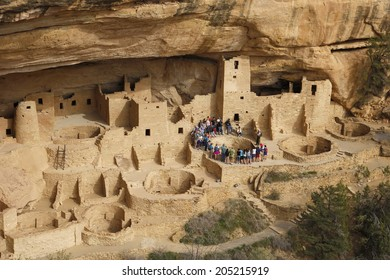 MESA VERDE, USA-APRIL 11: Unidentified people listen to ranger on April 11,2014 at Cliff Palace in Mesa Verde National Park, USA. Mesa Verde is the largest archaeological preserve in the United States