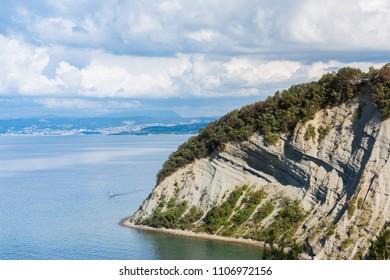 Mesecev zaliv (Moon Bay), Strunjan, Slovenia. Mediterranean coastline with Italian board