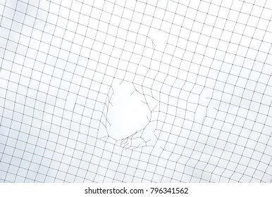 Mesh netting with hole on sky background