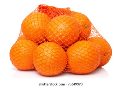 Mesh oranges from the supermarket. Isolated on white background
