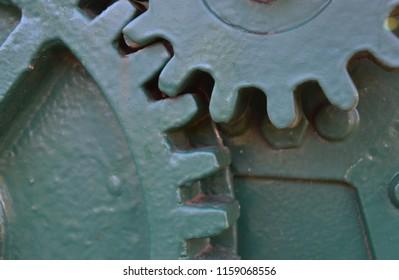 Meshed gear cogs working together on heavy industrial vintage pump in Mildura