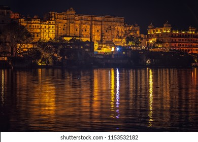 Mesmerizing reflections of well lit the city  Palace, Udaipur, Rajasthan, India.