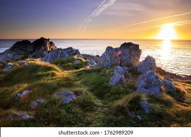 A mesmerizing scenery of a rocky shore during sunset-perfect wallpaper or background