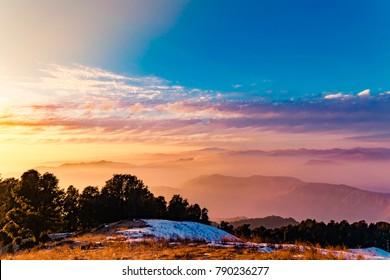 Mesmerizing view of cloudy blue sky background during sunset enroute to Nag tibba trekking trail from Pantwari to Jhandi peak, Dehradun, Garhwal region, Uttarakhand, India.