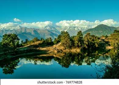 Mesmerizing view at Deoria Tal or Lake nestled in Garhwal Himalayas at  Chopta, Uttarakhand, India. This lake is a camping location for Tungnath Chandrashila hiking trail.