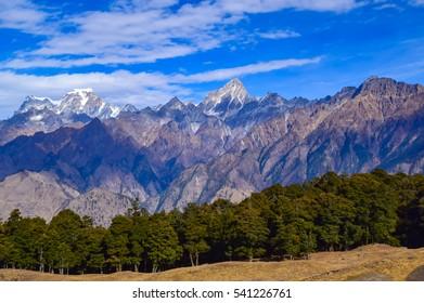 Mesmerizing view of Dunagiri and Elephant mountains of Garhwal Himalayas from Kuari pass hiking trail near Auli,Uttrakhand,India.