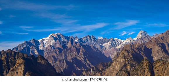 Mesmerizing view of Kamet, Parvati and Neelkanth mountains of Garhwal Himalayas from Kuari pass hiking trail near Auli,Uttrakhand,India.