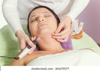 Mesotherapy, anti ageing treatment. Woman having mesotherapy facial treatment at beauty salon.  Close up