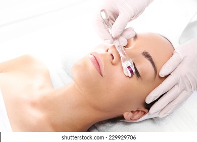 Mesotherapy, around the eyes, anti-wrinkle treatment. Rejuvenation, beautification, the woman at the beautician, Mesotherapy microneedle