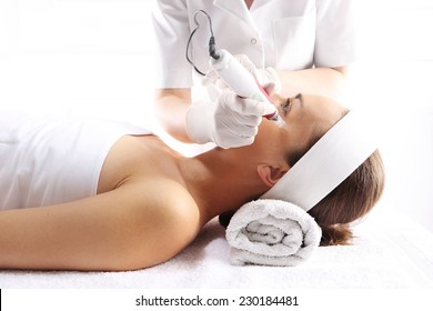 Mesotherapy, needle mesotherapy , a cosmetic procedure Beautician performs a needle mesotherapy treatment on a woman's face