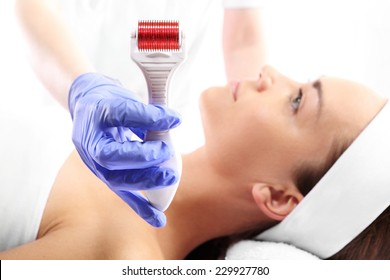 Mesotherapy treatment of baldness.Rejuvenation, beautification, the woman at the beautician, Mesotherapy microneedle