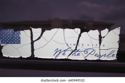 Mesquite, TX USA May 19, 2017: `We The People bumper sticker; a large crack after the US flag and one between `We` and `The People`, perfectly representing the fractured state of the United States.