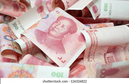 mess chinese yuan money 100 rmb background with Mao Zedong portrait old money