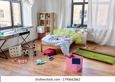 mess, disorder and interior concept - view of messy home kid's room with scattered stuff
